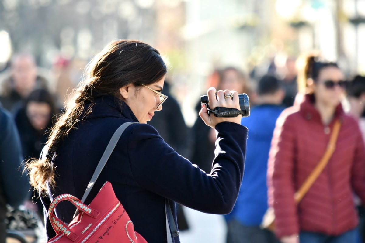 confident, crowd, photojournalist, pretty, shoulder, urban area, video recording, person, woman, street