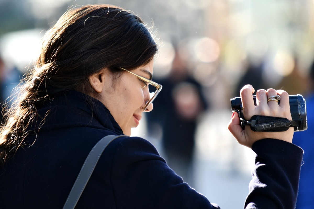 businesswoman, camcorder, confident, move, photojournalist, side view, smile, woman, street, girl