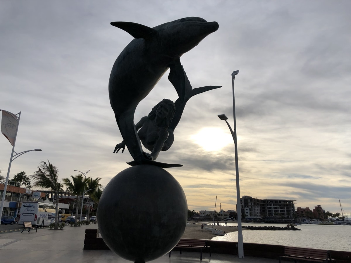 bronze, sculpture, woman, dolphin, water, museum, sea, people, city, beach