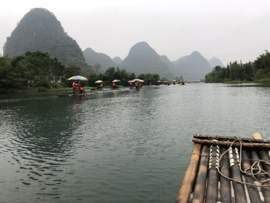 Asia, China, ecotourism, people, rafting, tourist attraction, watercraft, water, shore, lakeside