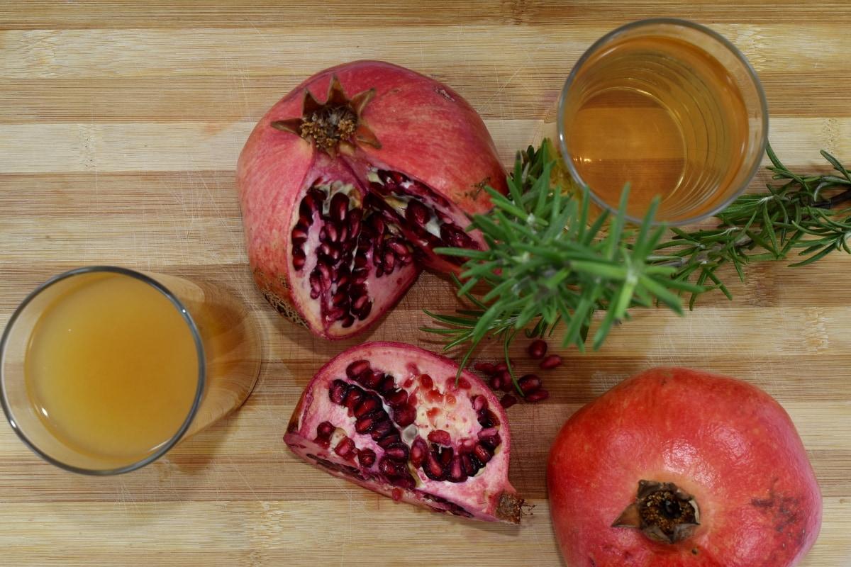 citrus, fruit juice, rosemary, seed, tropical, pomegranate, produce, food, wood, vegetable