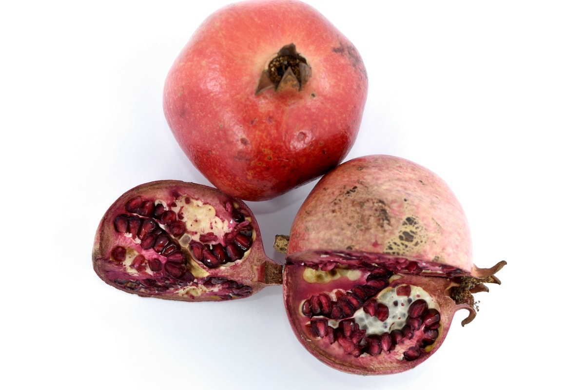agriculture, antioxidant, diet, eat, half, pomegranate, produce, whole, fresh, sweet