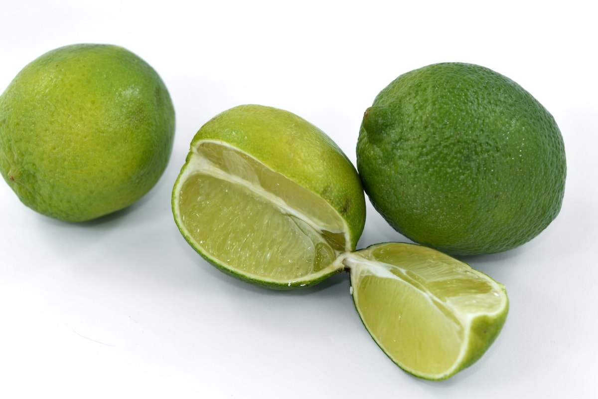 bitter, cross section, exotic, fresh, key lime, organic, ripe fruit, slice, tropical, vegetarian