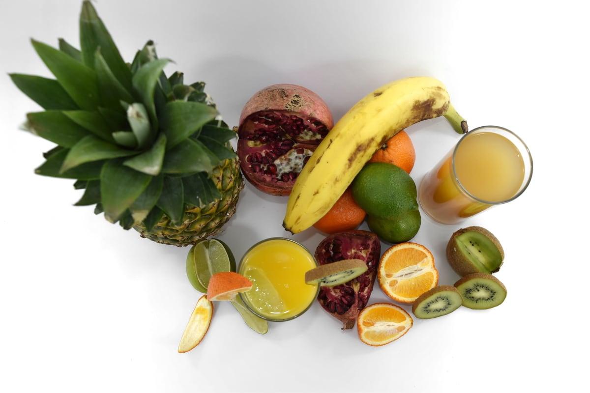 fruit, fruit cocktail, fruit juice, key lime, kiwi, oranges, pineapple, pomegranate, tropical, food