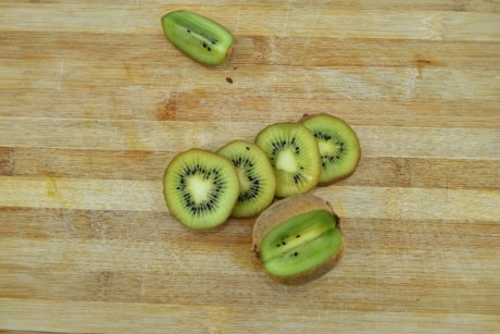 antioxidant, aroma, carbohydrate, dark green, fruit, kitchen table, kiwi, slices, fresh, food