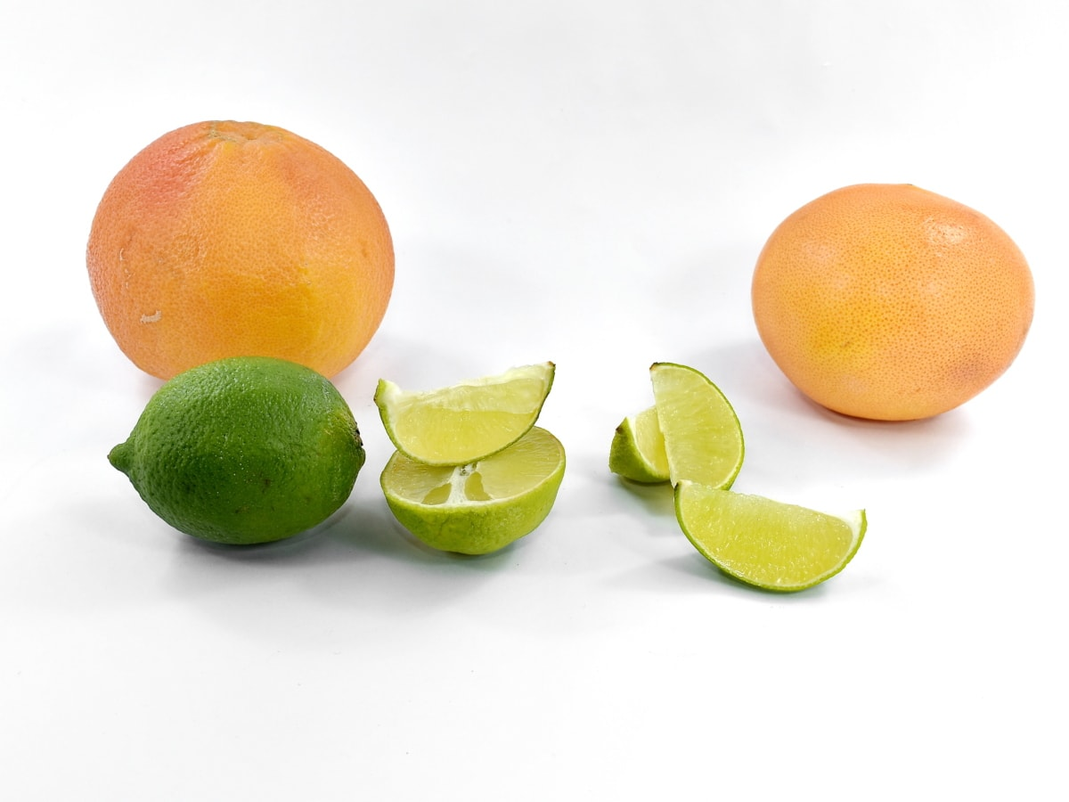 bitter, fresh, grapefruit, key lime, lemon, ripe fruit, slices, whole, vitamin, juice