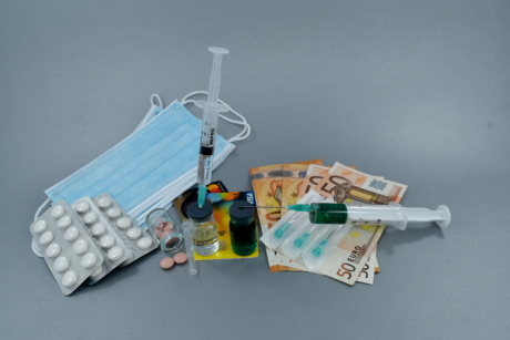 cure, drugs, face mask, hygiene, medication, painkiller, paper money, pills, protection, syringe