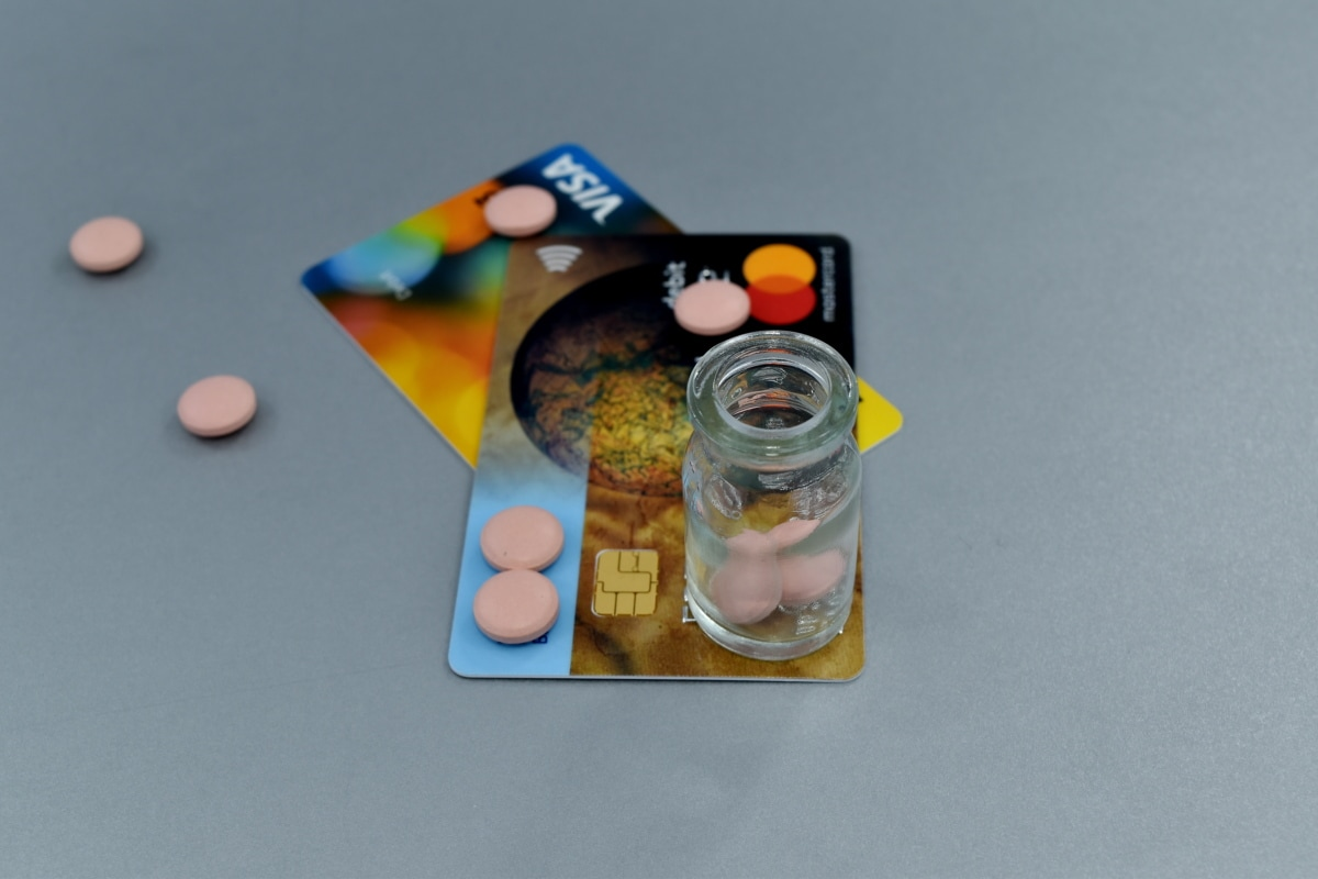 card, cost, dollar, drugs, economic growth, economy, money, pills, plastic, still life