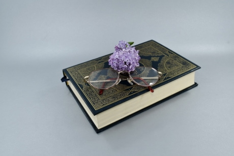book, eyeglasses, flower, knowledge, lilac, magnification, poetry, reading, still life, art