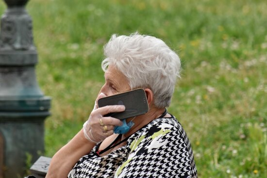 communication, elderly, face mask, gloves, grandmother, internet, latex, mobile phone, woman, outdoors