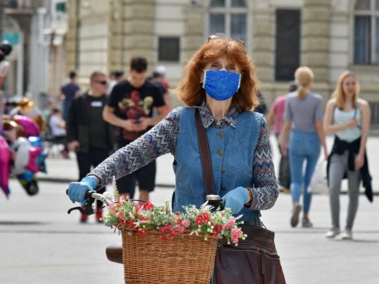 bicycle, crowd, face mask, gloves, gorgeous, infectious disease, people, protection, urban area, woman