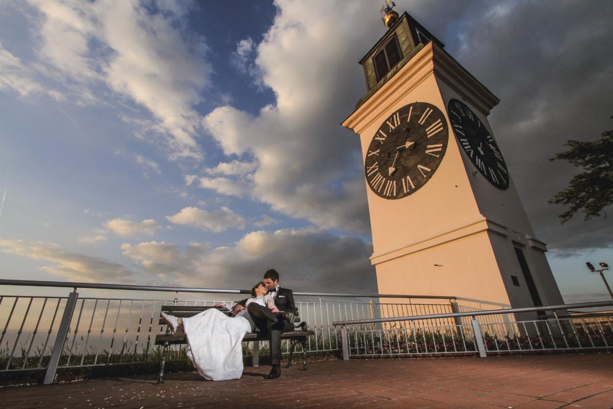 analog clock, groom, kiss, landmark, pretty, relaxation, sunset, tower, wife, architecture