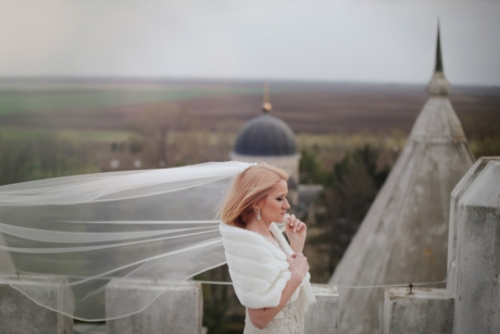 beautiful, bride, castle, dress, fortress, hairstyle, landmark, side view, veil, wind