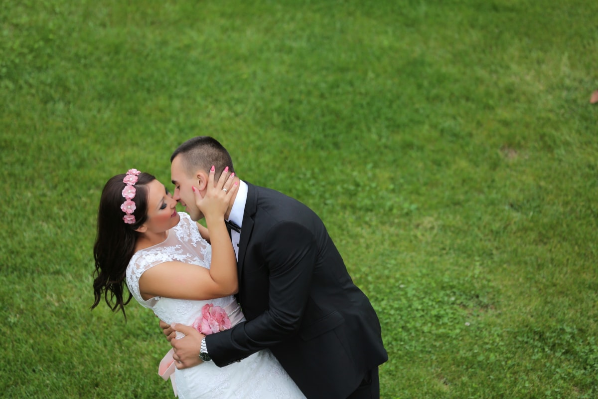 enjoyment, hug, kiss, man, pretty girl, suit, groom, couple, wedding, grass