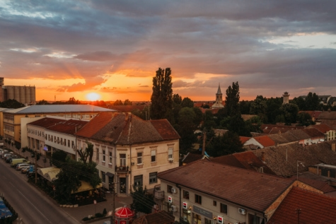aerial, buildings, houses, roofs, rooftop, street, sunset, town, building, roof