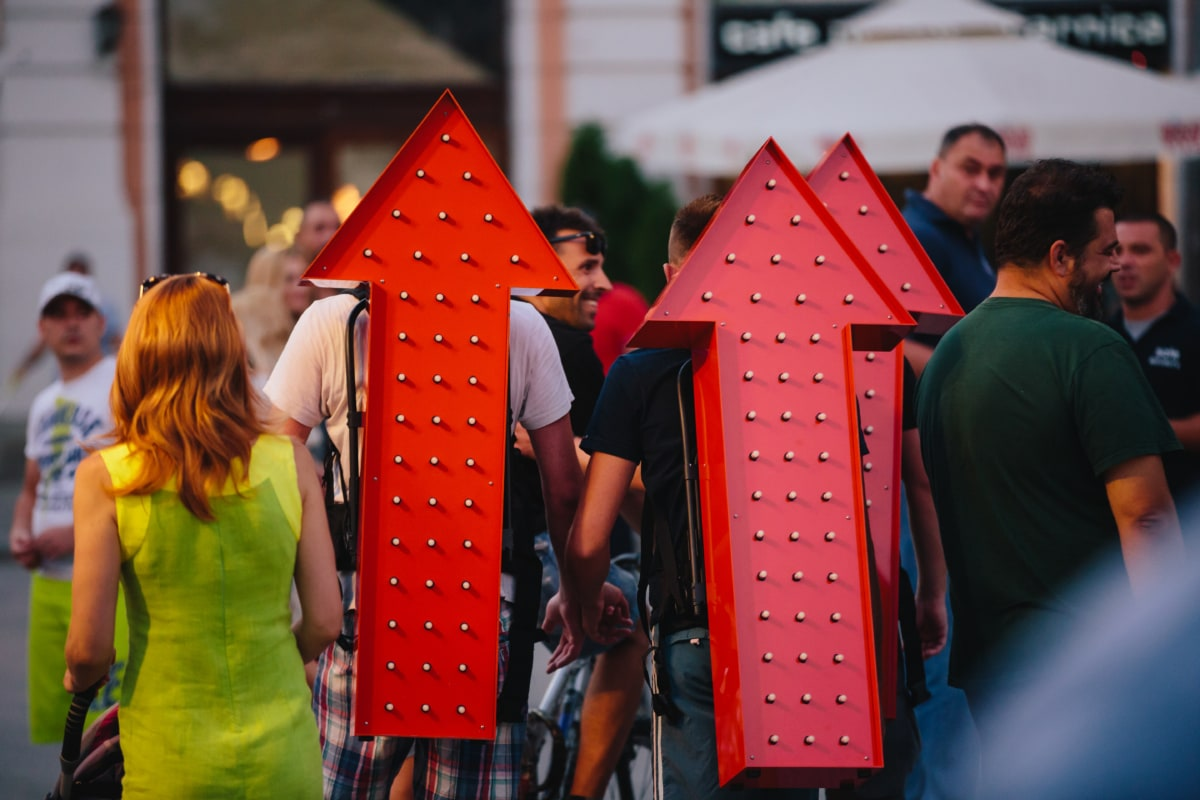 arrow, crowd, downtown, evening, event, manifestation, object, person, people, happy