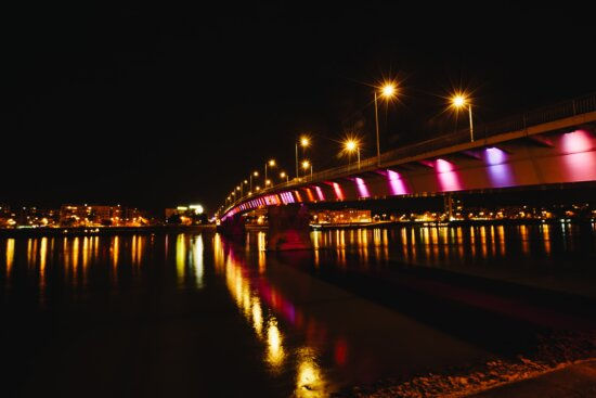 architectural style, bridge, light bulb, reflection, reflector, riverbank, water, pier, device, city