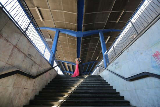 businessman, couple, handsome, hug, people, pretty girl, romantic, staircase, subway, subway station