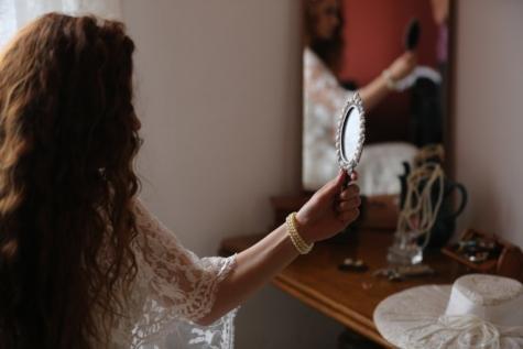 bracelet, bride, brunette, hairstyle, hand, hat, jewelry, mirror, pearl, wedding dress