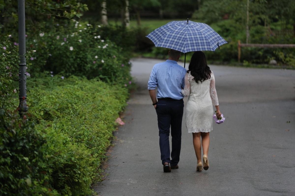 fashion, glamour, groom, legs, rain, togetherness, umbrella, walking, wedding bouquet, wedding dress