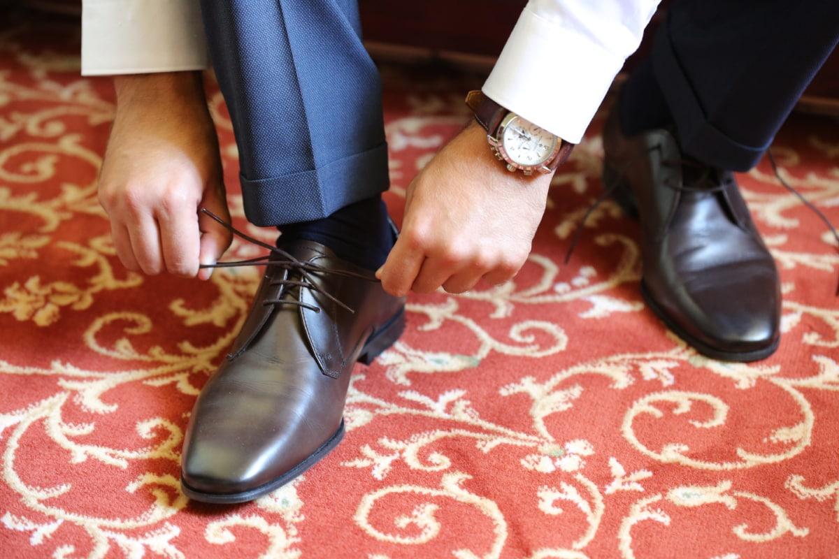 analog clock, businesswoman, carpet, elegance, leather, rug, shoelace, shoes, wristwatch, footwear