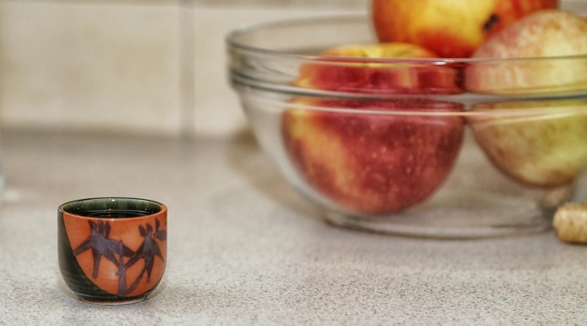 apples, bowl, drink, liquid, mug, glass, cup, tea, food, breakfast