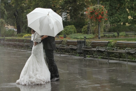 bad weather, hug, kiss, rain, romantic, suit, wedding, wedding dress, bride, umbrella