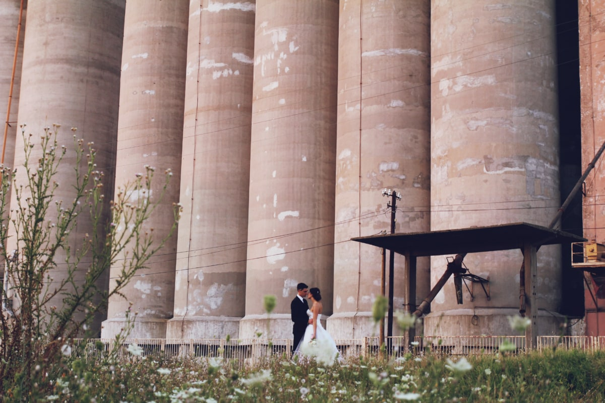 bride, groom, hug, industry, romantic, silo, spring time, column, architecture, outdoors