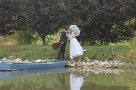groom, guitarist, kiss, musician, riverbank, umbrella, wedding dress, water, girl, people