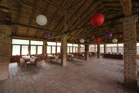 bricks, ceiling, chairs, floor, lantern, party, restaurant, tables, architecture, building