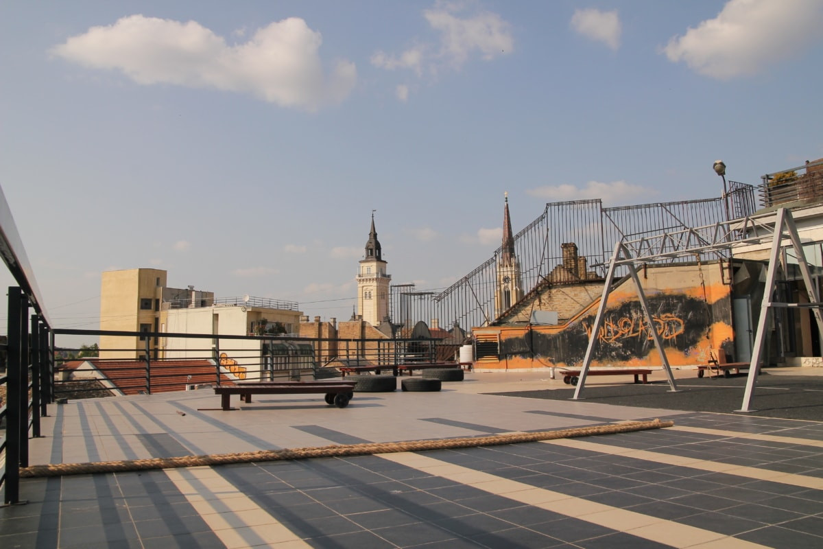 rooftop, playground, urban area, graffiti, buildings, architecture, city, pier, street, sunset