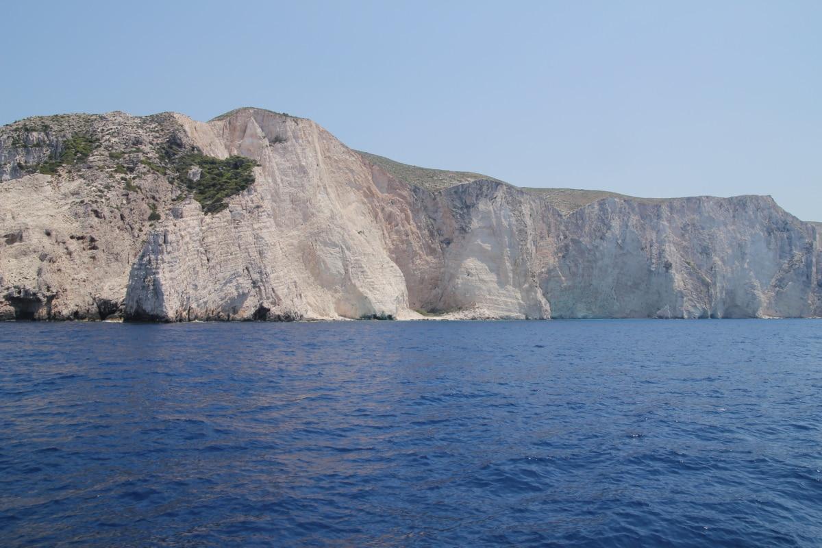 island, cliff, coastline, water, mountain, ocean, sea, landscape, nature, seashore