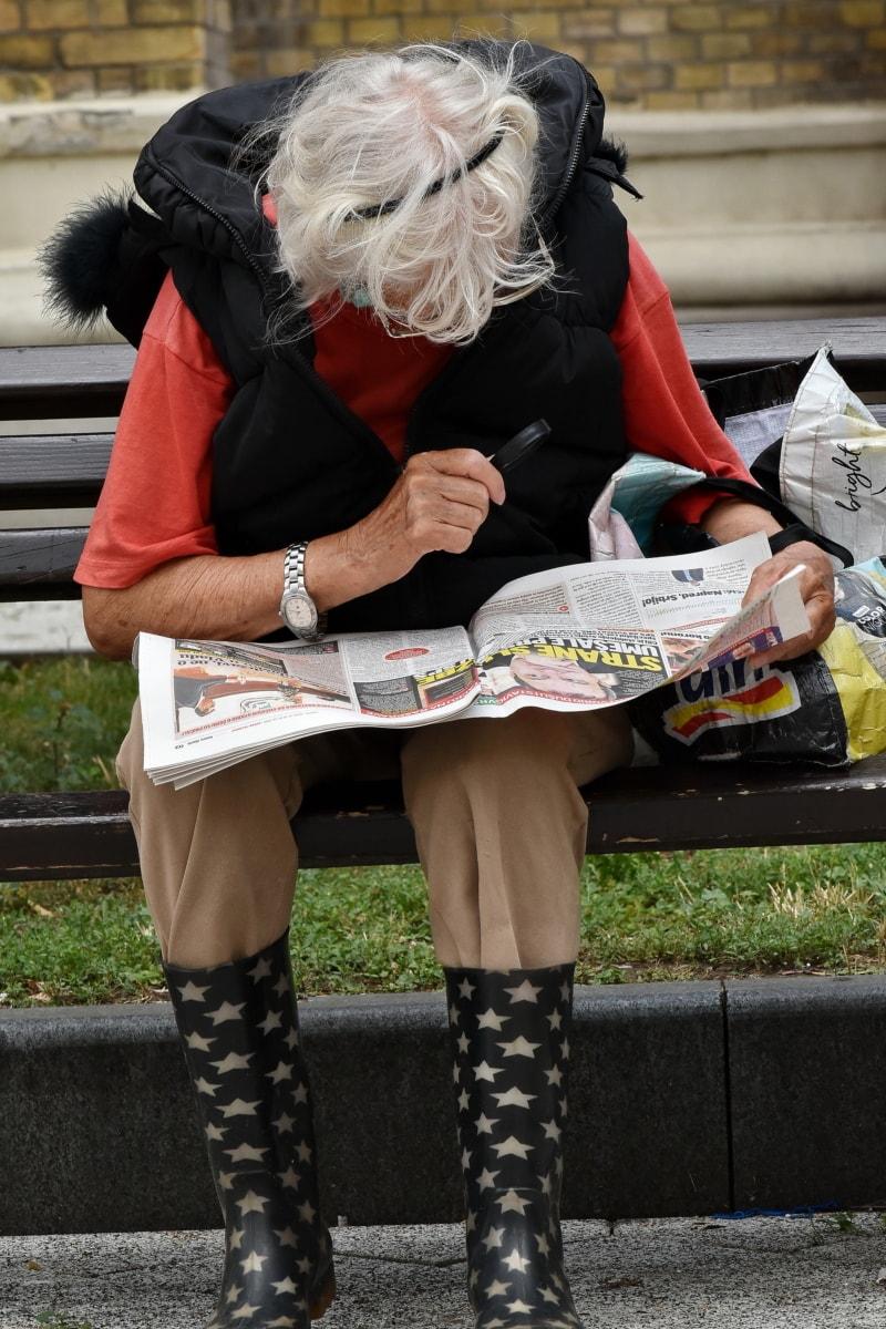 elderly, newspaper, reading, woman, eye disease, street, people, urban, outdoors, education