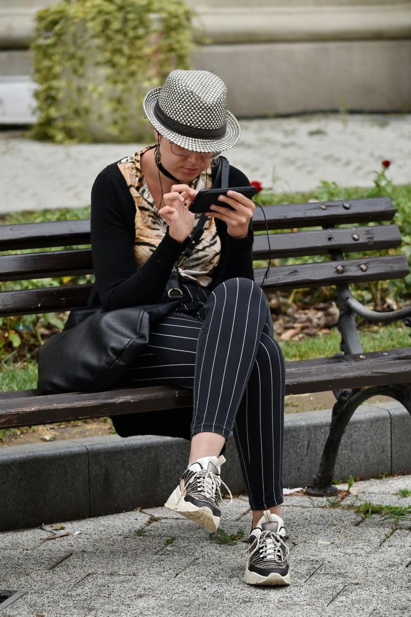 mobile phone, woman, wireless, sitting, outfit, street, bench, outdoors, people, portrait