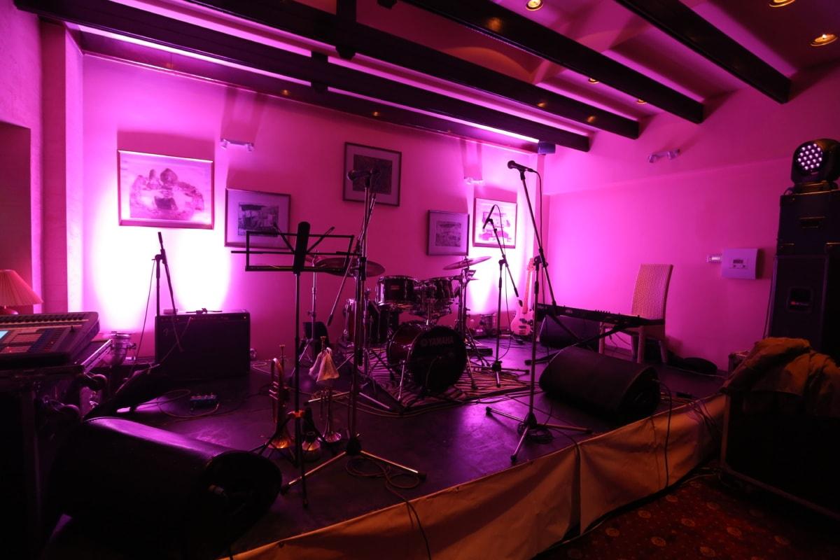 drum, nightclub, concert hall, instrument, microphone, interior, room, light, music, furniture