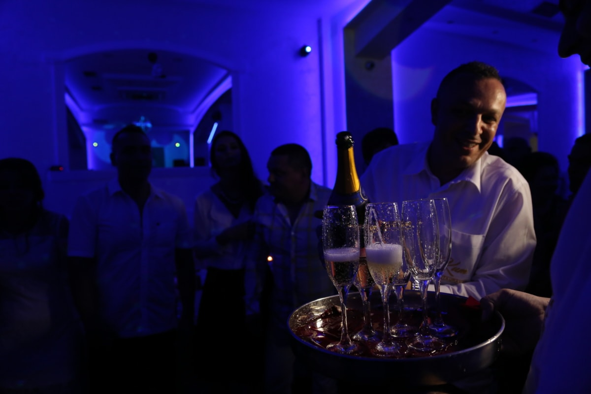 champagne, white wine, discotheque, nightlife, nightclub, restaurant, bartender, ceremony, bottle, people