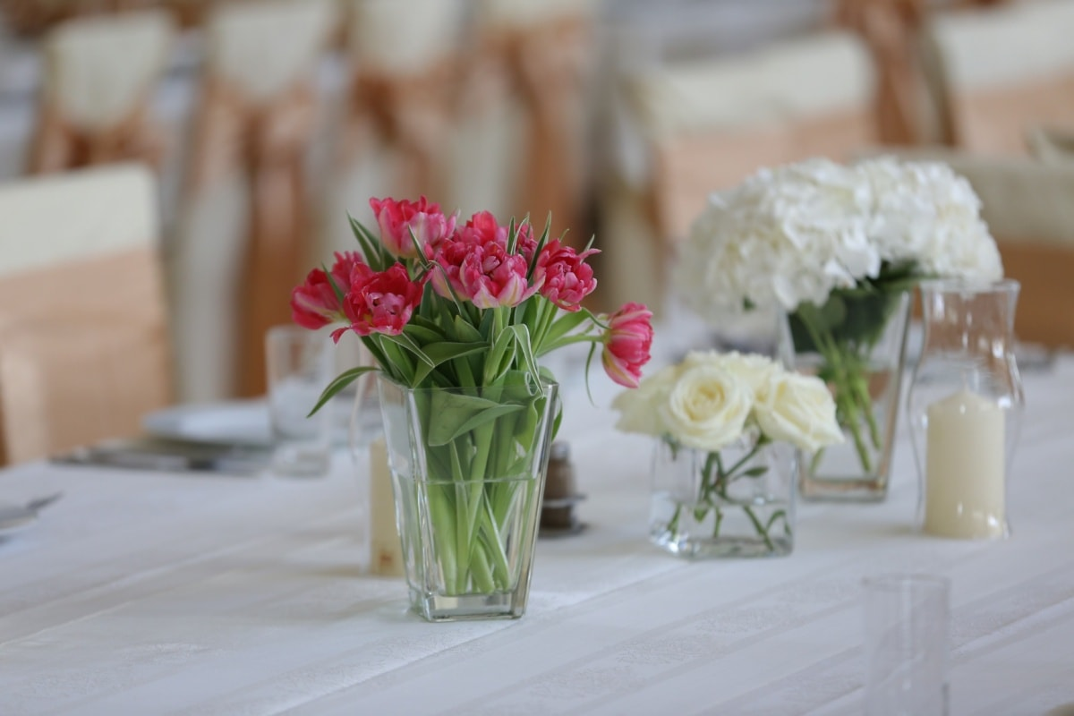 candle, vase, candlestick, tulips, dining area, tablecloth, chairs, decoration, arrangement, flower