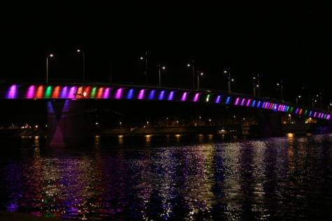 bridge, rainbow, night, calm, nighttime, river, cityscape, structure, city, architecture