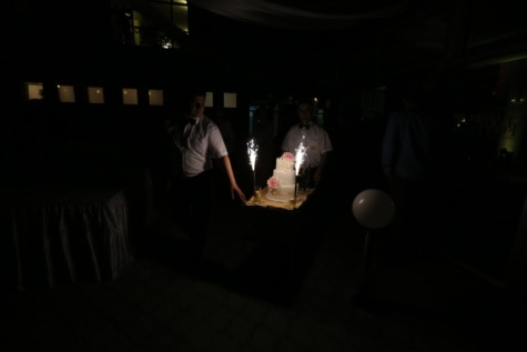 bartender, birthday, birthday cake, nightclub, nighttime, restaurant, darkness, spark, light, people