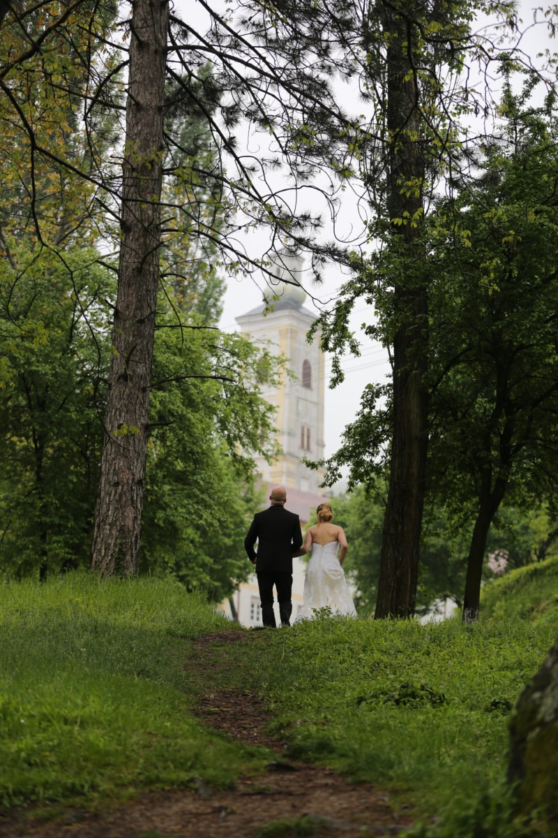 husband, wife, walking, man, woman, forest trail, wedding, wedding dress, fashion, church tower