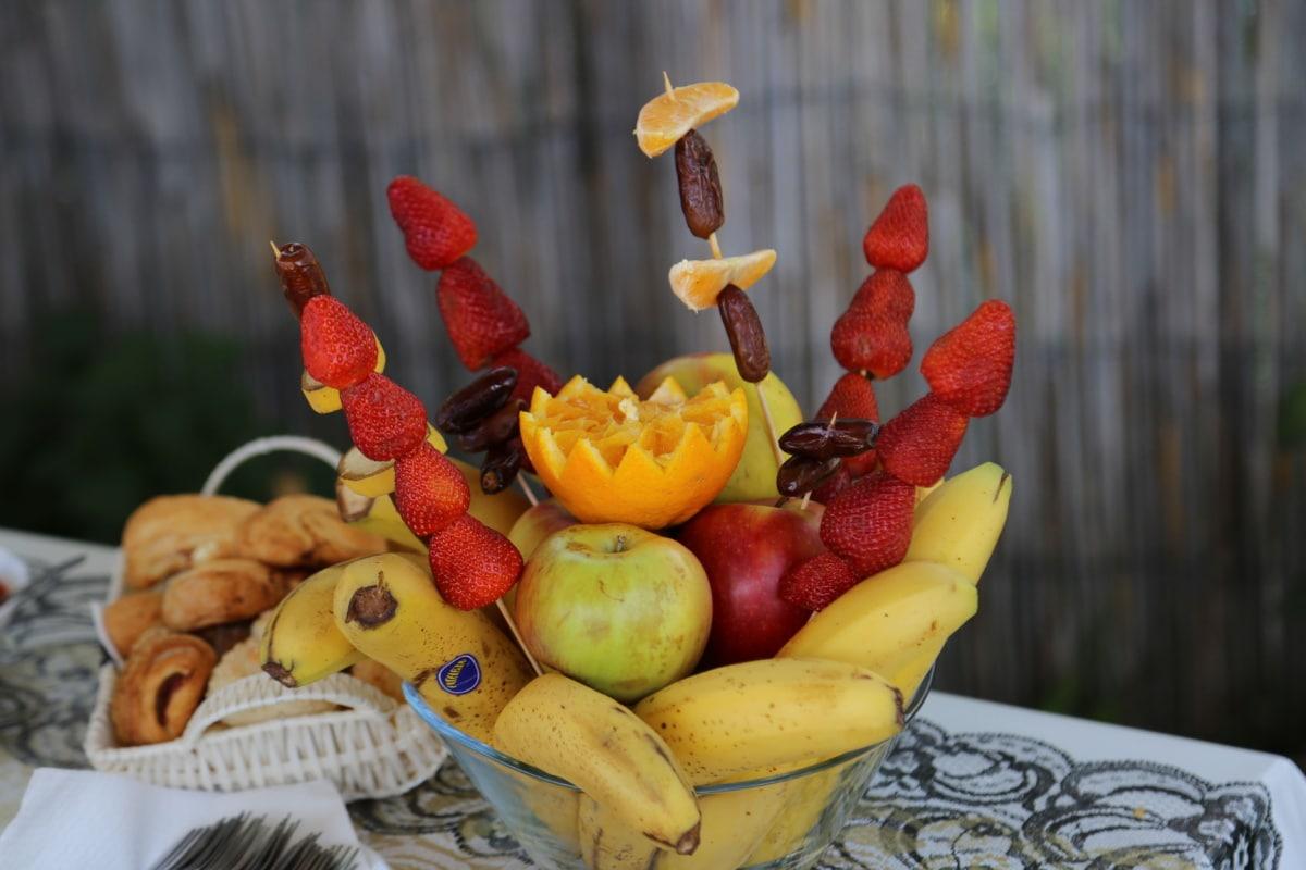 Erdbeeren, Banane, Äpfel, Backwaren, Tabelle, vom Buffet, Frühstück, Schüssel, Tischdecke, Essen