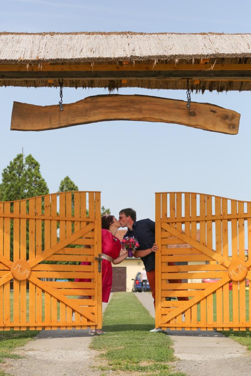 kiss, wife, husband, villager, gate, village, wood, wooden, fence, old