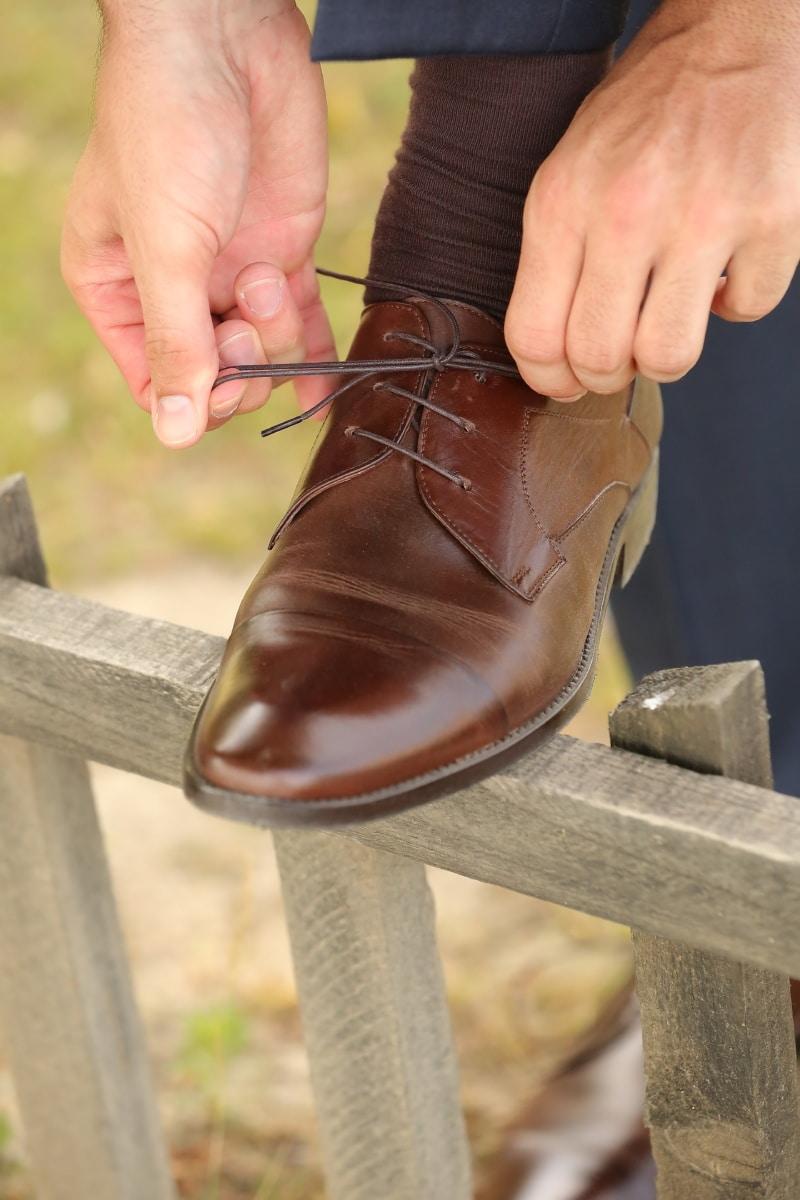 shoelace, light brown, shoe, sock, hands, picket fence, businessman, footwear, hand, foot