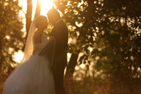 hug, embrace, beautiful photo, sunny, sunrays, bride, groom, sun, candle, wedding