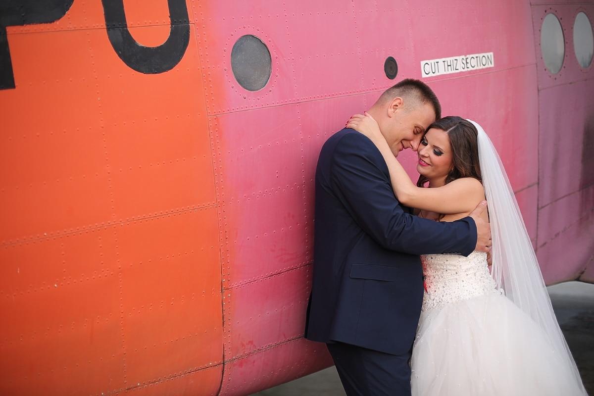 boyfriend, pilot, husband, wife, wedding dress, bride, biplane, airplane, embrace, hugging