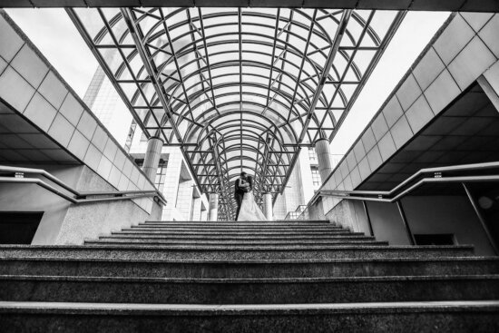 stairs, perspective, architectural style, kiss, groom, building, bride, symmetry, modern, city