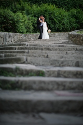 bride, embrace, groom, hug, stairs, maze, architecture, stone, history, old