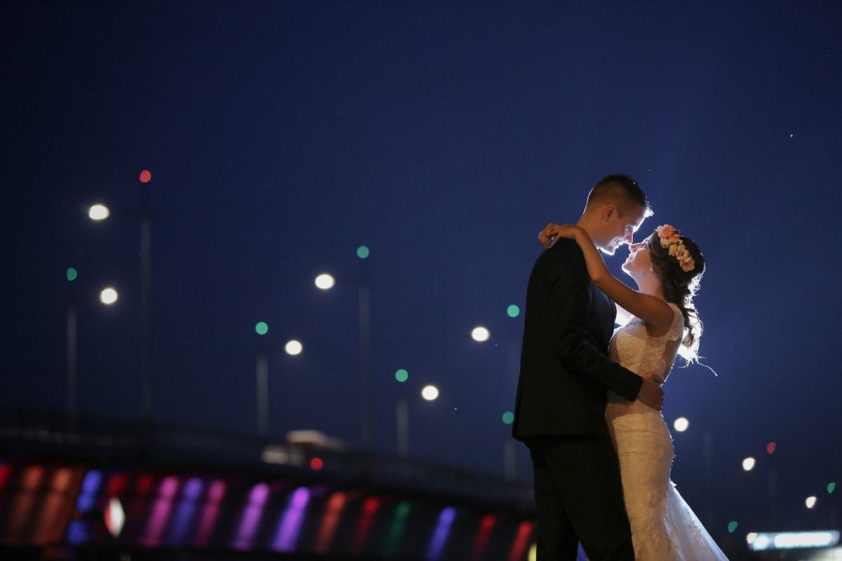 smiling, hugging, bride, love, groom, nighttime, nightlife, lights, person, light