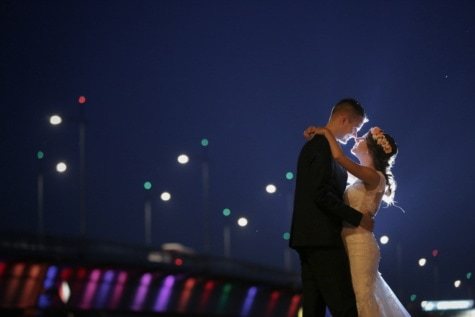 smiling, hugging, bride, love, groom, nighttime, nightlife, lights, person, light