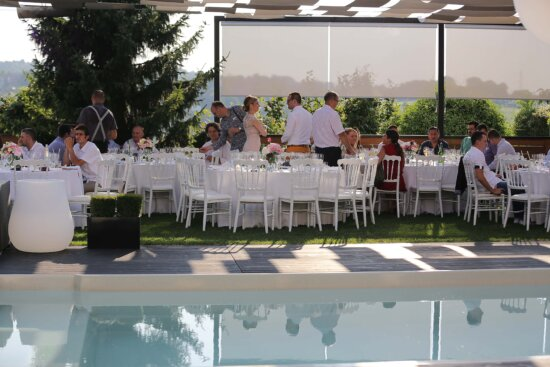 party, swimming pool, ceremony, bartender, meeting, table, dining, patio, structure, restaurant